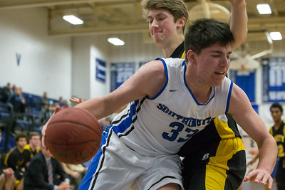Southington's Jeremy Mercier (33) looks baseline on Amity's Christopher Winkel (44) Tuesday at Southington High School in Southington Dec. 29, 2015 | Justin Weekes / For the Record-Journal
