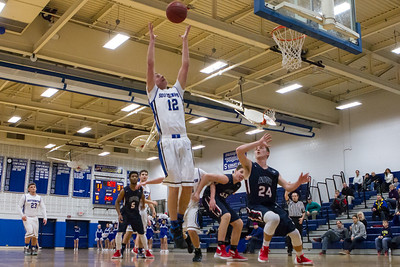 Southington's Jack Herms reaches for a rebound Thursday at Southington High School in Southington  Feb. 11, 2016 | Justin Weekes / For the Record-Journal