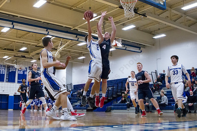 Southington's Michael DeFeo puts up a layup as Avon's Ian McDonald tries to block Thursday at Southington High School in Southington  Feb. 11, 2016 | Justin Weekes / For the Record-Journal
