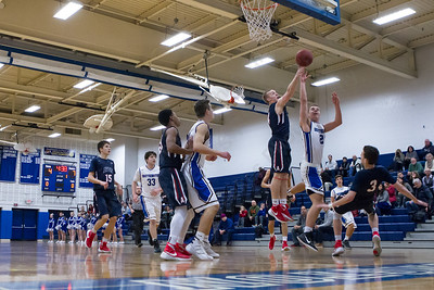Southington's Mark Lindberg puts up a shot as Avon's Ian McDonald defends Thursday at Southington High School in Southington  Feb. 11, 2016 | Justin Weekes / For the Record-Journal