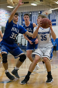 Southington's Andrew Lohneiss drives on Hall's Jack Del Coro Monday at Southington High School in Southington January 8, 2018 | Justin Weekes / Special to the Record-Journal