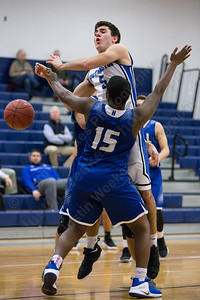 Southington's Timothy O'Shea gets fouled by Hall's Michael Hardwick Monday at Southington High School in Southington January 8, 2018 | Justin Weekes / Special to the Record-Journal