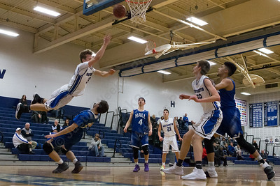 Southington's Andrew Lohneiss gets called for a charge on Hall's Jack Del Coro  Monday at Southington High School in Southington January 8, 2018 | Justin Weekes / Special to the Record-Journal