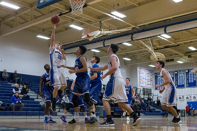 Southington's Andrew Lohneiss puts in a layup Monday at Southington High School in Southington January 8, 2018 | Justin Weekes / Special to the Record-Journal