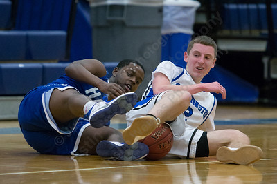 Southington's Ryan Gesnaldo and Hall's Michael Hardwick battles for possession Monday at Southington High School in Southington January 8, 2018 | Justin Weekes / Special to the Record-Journal