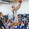 Southington's Colin Burdette puts in a layup off a fast break Friday at Southington High School in Southington December 14, 2018 | Justin Weekes / Special to the Record-Journal