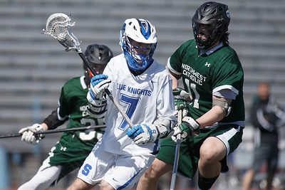 Southington's Evan Johanns gets past defenders Saturday at Southington High School in Southington April 21, 2018 | Justin Weekes / Special to the Record-Journal