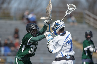 Southington's Evan Johanns is challenged by Northwest Catholic's goalie John Lewis Saturday at Southington High School in Southington April 21, 2018 | Justin Weekes / Special to the Record-Journal