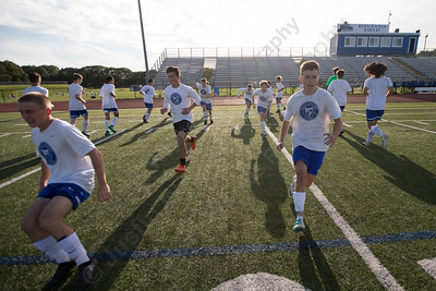 Southington boys soccer warms up for a scrimmage with Granby Memorial Friday during practice at Southington High School in Southington Sep. 1, 2017 | Justin Weekes / For the Record-Journal