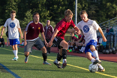 Southington's Hayden Burbank works past a defender Friday during practice at Southington High School in Southington Sep. 1, 2017 | Justin Weekes / For the Record-Journal