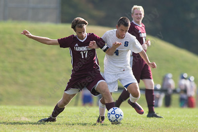 Southington's Colin Burdette and Farmington's John DiTommaso battle for possession Monday at Southington High School in Southington September 25, 2017 | Justin Weekes / For the Record-Journal