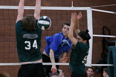 Southington's Timothy Walsh gets a spike through Maloney blockers Wednesday at Maloney High School in Meriden April 25, 2018 | Justin Weekes / Special to the Record-Journal