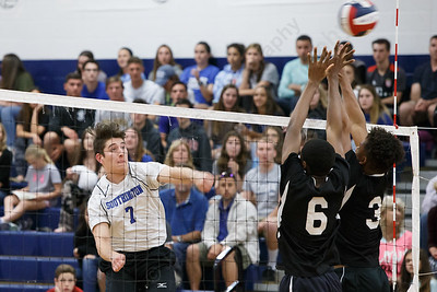 Southington's William Pfanzelt drives a spike past blockers Friday at Southington High School in Southington May 18, 2018 | Justin Weekes / Special to the Record-Journal
