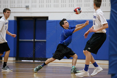 Southington's Niko Sophroniou digs a volley Friday at Southington High School in Southington May 18, 2018 | Justin Weekes / Special to the Record-Journal