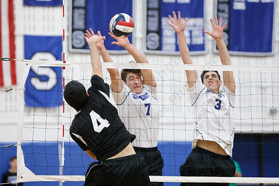 Southington's William Pfanzelt left and Rocco Possidento block a spike Friday at Southington High School in Southington May 18, 2018 | Justin Weekes / Special to the Record-Journal