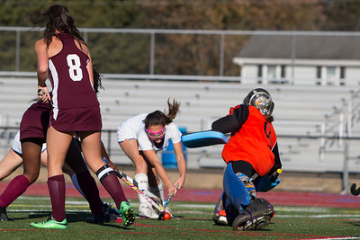 Southington's Megan Matthews scores on Windsor's Kayleigh Morgan Tuesday at Fontana Field in Southington October 17, 2017 | Justin Weekes / For the Record-Journal