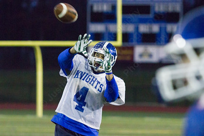 Southington's Richard Rivera completes a pass Thursday as the Blue Knights prepare for the the CIAC class LL semifinal with Darien at Fontana Field in Southington Dec. 1, 2016 | Justin Weekes / For the Record-Journal