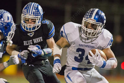 Southington's Vance Upham carries for a first down Monday during the CIAC class LL semifinal at Joe Boyle Stadium in Stamford Dec. 5, 2016 | Justin Weekes / For the Record-Journal