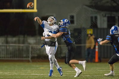 Southington's William Barmore throws away the ball as Darien's Quinlin Fay pressures Monday during the CIAC class LL semifinal at Joe Boyle Stadium in Stamford Dec. 5, 2016 | Justin Weekes / For the Record-Journal