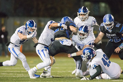 Southington's defense stops Darien's Mitchell Pryor Monday during the CIAC class LL semifinal at Joe Boyle Stadium in Stamford Dec. 5, 2016 | Justin Weekes / For the Record-Journal