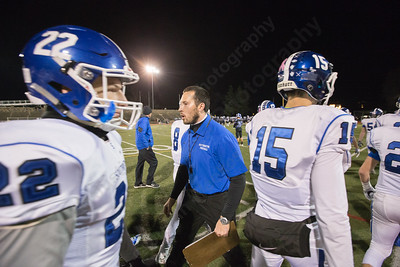 Southington's head coach Mike Drury talks to the team before kick off Monday during the CIAC class LL semifinal at Joe Boyle Stadium in Stamford Dec. 5, 2016 | Justin Weekes / For the Record-Journal