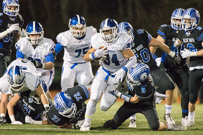 Southington's Vance Upham powers through Darien's line for a first down Monday during the CIAC class LL semifinal at Joe Boyle Stadium in Stamford Dec. 5, 2016 | Justin Weekes / For the Record-Journal