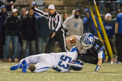 Southington's Robert Bunting gets to Darien's quarterback Brian Peters  for a loss Monday during the CIAC class LL semifinal at Joe Boyle Stadium in Stamford Dec. 5, 2016 | Justin Weekes / For the Record-Journal