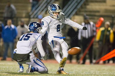 Southington's Nicholas Daddona kicks the extra point for the Blue Knights only score Monday during the CIAC class LL semifinal at Joe Boyle Stadium in Stamford Dec. 5, 2016 | Justin Weekes / For the Record-Journal