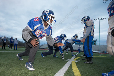 Southington's Robert Bunting runs through a defensive drill Thursday as the Blue Knights prepare for the the CIAC class LL semifinal with Darien at Fontana Field in Southington Dec. 1, 2016 | Justin Weekes / For the Record-Journal
