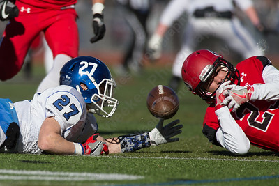 Southington's Tanner LaRosa and Cheshire's Bryce Levenduski dive for a loose ball Thursday during the 22nd Annual Apple Classic on Thanksgiving Day at Alumni Field on the campus of Cheshire High School in Cheshire. The Blue Knights of Southington defeated the Cheshire Rams 30 to 22. November 23, 2017 | Justin Weekes / For the Record-Journal
