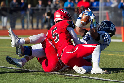 Southington's Ryan Montalvo gets brought down in the endzone for a touchdown Thursday during the 22nd Annual Apple Classic on Thanksgiving Day at Alumni Field on the campus of Cheshire High School in Cheshire. The Blue Knights of Southington defeated the Cheshire Rams 30 to 22. November 23, 2017 | Justin Weekes / For the Record-Journal