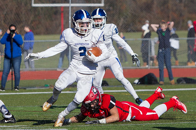Southington's Shaun Wagner returns an interception in the endzone to seal the Blue Knights win Thursday during the 22nd Annual Apple Classic on Thanksgiving Day at Alumni Field on the campus of Cheshire High School in Cheshire. The Blue Knights of Southington defeated the Cheshire Rams 30 to 22. November 23, 2017 | Justin Weekes / For the Record-Journal