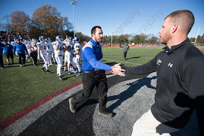 Southington's head coach Mike Drury and Cheshire's Don Drust shake hands after the game Thursday during the 22nd Annual Apple Classic on Thanksgiving Day at Alumni Field on the campus of Cheshire High School in Cheshire. The Blue Knights of Southington defeated the Cheshire Rams 30 to 22. November 23, 2017 | Justin Weekes / For the Record-Journal