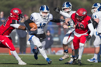Southington's Will Barmore finds space on a quarterback keeper Thursday during the 22nd Annual Apple Classic on Thanksgiving Day at Alumni Field on the campus of Cheshire High School in Cheshire. The Blue Knights of Southington defeated the Cheshire Rams 30 to 22. November 23, 2017 | Justin Weekes / For the Record-Journal