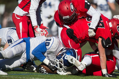 Southington's Joseph Koczera recovers a loose ball Thursday during the 22nd Annual Apple Classic on Thanksgiving Day at Alumni Field on the campus of Cheshire High School in Cheshire. The Blue Knights of Southington defeated the Cheshire Rams 30 to 22. November 23, 2017 | Justin Weekes / For the Record-Journal