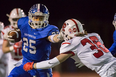 Southington's running back Tanner LaRosa tries to break the tackle attempt of Fairfield Prep's corner back Luke Hopkinsruns on a big gain for a first down Tuesday during the CIAC Class LL quarterfinal round at Fontana Field in Southington November 27, 2018 | Justin Weekes / Special to the Record-Journal