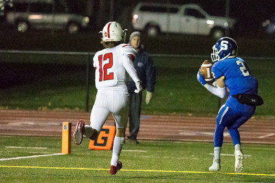 Southington's quarterback Jacob Drena finds wide receiver Carter Uhlman (2) in the endzone for a touchdown to put the Blue Knights on the board first Tuesday during the CIAC Class LL quarterfinal round at Fontana Field in Southington November 27, 2018 | Justin Weekes / Special to the Record-Journal