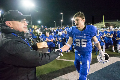 Southington's Tanner LaRosa received the game MVP award from Athletic Director Greg Ferry Wednesday during the 23rd Annual Apple Valley Classic at Fontana Field on the campus of Southington high School in Southington November 21, 2018 | Justin Weekes / Special to the Record-Journal
