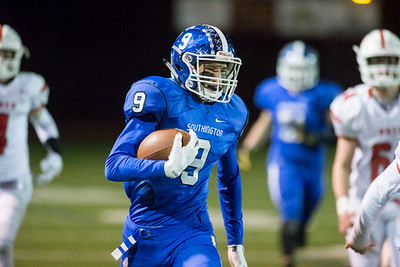Southington's defensive back William Downes runs back an interception into Fairfield Prep's territory Tuesday during the CIAC Class LL quarterfinal round at Fontana Field in Southington November 27, 2018   Justin Weekes / Special to the Record-Journal