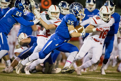 Southington's Tanner LaRosa finds running room on the right side Tuesday during the CIAC Class LL quarterfinal round at Fontana Field in Southington November 27, 2018   Justin Weekes / Special to the Record-Journal