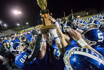 Southington Blue Knights celebrate with the Apple Valley Classic trophy after defeating the Cheshire Rams 23-13 Wednesday during the 23rd Annual Apple Valley Classic at Fontana Field on the campus of Southington high School in Southington November 21, 2018 | Justin Weekes / Special to the Record-Journal