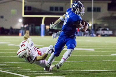 Southington's running back Tanner LaRosa shakes the tackle attempt of Fairfield Prep's safety Peter Kavanaugh while staying in bounds Tuesday during the CIAC Class LL quarterfinal round at Fontana Field in Southington November 27, 2018 | Justin Weekes / Special to the Record-Journal
