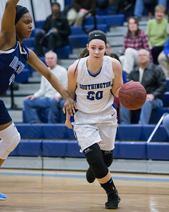 Southington's Natalie Wadolowski drives on Middletown's Brielle Wilborn Thursday during first round play in the CCC tournament at Southington High School in Southington Feb. 18, 2016 | Justin Weekes / For the Record-Journal