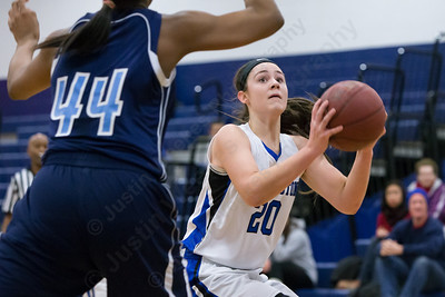 Southington's Natalie Wadolowski looks to put back a rebound as Middletown's Brielle Wilborn defends Thursday during first round play in the CCC tournament at Southington High School in Southington Feb. 18, 2016 | Justin Weekes / For the Record-Journal