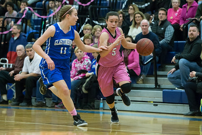 Southington's Margaret Meehan gets past Glastonbury's Caroline Bogue Friday at Southington High School in Southington Jan. 29, 2016 | Justin Weekes / For the Record-Journal