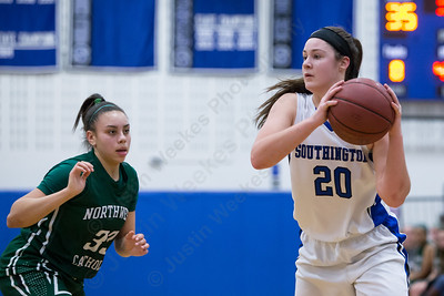 Southington's Natalie Wadolowski looks for Diana Verderame on the low post as Northwest Catholic's Elizabeth Jacobs defends Monday at Southington High School in Southington Jan. 25, 2016 | Justin Weekes / For the Record-Journal