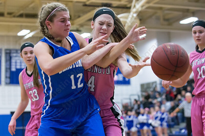 Southington's Sarah Minkiewicz and Glastonbury's Madison Seymour reach for a rebound Friday at Southington High School in Southington Jan. 29, 2016 | Justin Weekes / For the Record-Journal