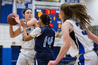 Southington's Natalie Wadolowski looks for her sister Janette Wadolowski (33) as Middletown's Briajh Harrell defends Thursday during first round play in the CCC tournament at Southington High School in Southington Feb. 18, 2016 | Justin Weekes / For the Record-Journal