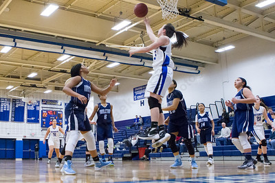 Southington's Margaret Meehan puts in the reverse lay up Thursday during first round play in the CCC tournament at Southington High School in Southington Feb. 18, 2016 | Justin Weekes / For the Record-Journal