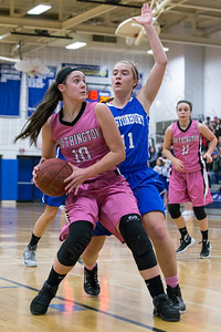 Southington's Natalie Wadolowski works the low post on Glastonbury's Caroline Bogue Friday at Southington High School in Southington Jan. 29, 2016 | Justin Weekes / For the Record-Journal